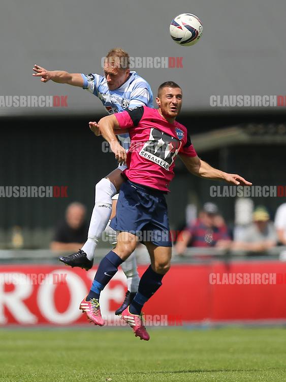 FODBOLD: Bobby Alm Nilsson (FC Helsingør) vinder hovedstødsduel med Olcay Senoglu (B.93) under kampen i 2. Division Øst mellem FC Helsingør og B.93 den 1. juni 2014 på Helsingør Stadion. Foto: Claus Birch