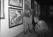 "Pauline Bewick Art Exhibition..1986..03.06.1986..06.03.1986..3rd June 1986..At the Guinness Hop Store,Dublin,artist Pauline Bewick is having an exhibition of her work.The exhibition called ""2 to 50 years""is a display of her work from age 2 to the present.the art work ranges from simple pencil sketches to more complex paintings and lino cuts...Picture shows the artist,Pauline Bewick,discusses her painting ""Madame Butterfly' with her friend Ms Stam Mintz. Ms Mintz assisted Pauline with the hanging of her work for the exhibition."