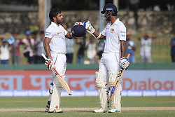 August 5, 2017 - Colombo, Sri Lanka - Sri Lankan cricketer Dimuth Karunaratne(R) joins in to celebrate after Kusal Mendis scored a  century (100 runs) during the 3rd Day's play in the 2nd Test match between Sri Lanka and India at the SSC international cricket stadium at the capital city of Colombo, Sri Lanka on Saturday 5th August 2017. (Credit Image: © Tharaka Basnayaka/NurPhoto via ZUMA Press)