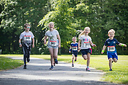 NO FEE PICTURES<br /> 19/5/18 Hundreds of people of all ages lapped up the summer sunshine when they came out to support an important cause which is close to many of their hearts, organ donation, by taking part in the Irish Kidney Association's 'Run for a Life' family fun run which took place at Corkagh Park, Clondalkin, Dublin 22 on Saturday 19th May.   (www.runforalife.ie) Pictured Millie Pitcher (second from left), 8, kidney transplant receipiant with friends. . Picture:Arthur Carron