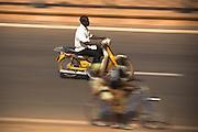 Man riding a moped in Ouagadougou, Burkina Faso on Sunday November 2, 2008.