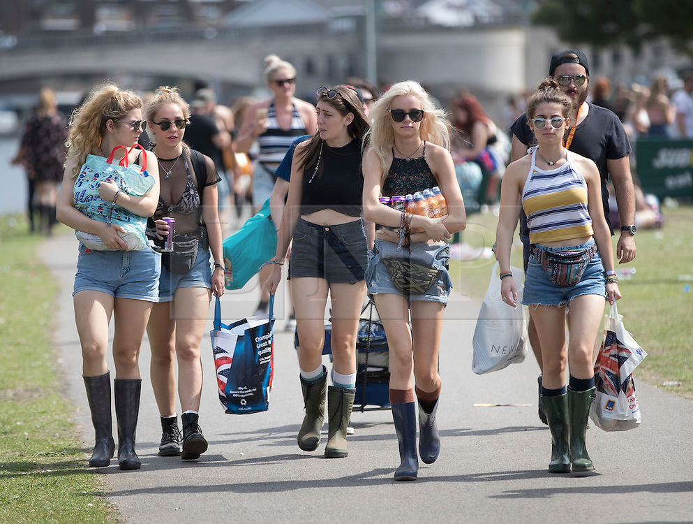 © Licensed to London News Pictures. 25/08/2016. Reading, UK. Crowds make their to Reading Festival. Mixed weather is expected to greet the start of the three day music festival. Photo credit: Peter Macdiarmid/LNP