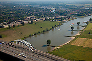 Nederland, Utrecht, Vianen, 23-06-2010; scheepvaartverkeer op de Lek ter hoogte van de Lekbrug Vianen. Foto naar het noorden, naar Nieuwegein..Shipping at the Lek near the Lekbrug Vianen. .luchtfoto (toeslag), aerial photo (additional fee required).foto/photo Siebe Swart
