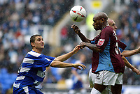 Fotball<br /> 2004/2005<br /> Foto: SBI/Digitalsport<br /> NORWAY ONLY<br /> <br /> Reading v Burnley<br /> The League Championship. 02/10/2004<br /> <br /> Nicky Forster of Reading clashes with Frank Sinclair of Burnley