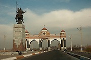 General view of the gates marking the entrance to the city of Jalal-Abad, built in 2002, and the equestrian statue of national Kyrgyz hero Kurmanbek Batyr.
