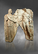 Roman Sebasteion relief  sculpture of Demeter and Triptolemos, Aphrodisias Museum, Aphrodisias, Turkey.  Against a grey background.<br /> <br /> Deneter - stately, veiled and holding a sceptre - hands a bunch of wheat stalks to the young hero Trptolomos. Demeter was the grain goddess, and it was Triptolemos, a hero from Eleusis near Athens, whom she chose to bring grain cultivation to mankind .<br /> <br /> If you prefer to buy from our ALAMY STOCK LIBRARY page at https://www.alamy.com/portfolio/paul-williams-funkystock/greco-roman-sculptures.html . Type -    Aphrodisias     - into LOWER SEARCH WITHIN GALLERY box - Refine search by adding a subject, place, background colour, museum etc.<br /> <br /> Visit our ROMAN WORLD PHOTO COLLECTIONS for more photos to download or buy as wall art prints https://funkystock.photoshelter.com/gallery-collection/The-Romans-Art-Artefacts-Antiquities-Historic-Sites-Pictures-Images/C0000r2uLJJo9_s0