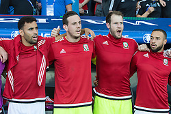 TOULOUSE, FRANCE - Monday, June 20, 2016: Wales substitutes line-up to sing the National Anthem ahead of the final Group B UEFA Euro 2016 Championship match against Russia at Stadium de Toulouse. Hal Robson-Kanu, goalkeeper Danny Ward, goalkeeper Owain Fon Williams and Ashely 'Jazz' Williams. (Pic by Paul Greenwood/Propaganda)