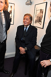 VALENTINO GARAVANI at a private view of photographs by Anthony Souza held at The Little Black Gallery, 13A Park Walk, London SW10 on 13th December 2011.