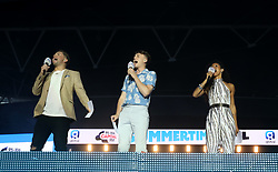 Vick Hope, Roman Kemp and Sonny Jay on stage during Capital's Summertime Ball. The world's biggest stars perform live for 80,000 Capital listeners at Wembley Stadium at the UK's biggest summer party.
