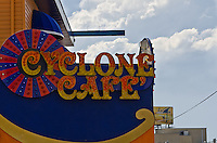 """Sign of the cafe across the street from """"The Cyclone"""", a famous wooden roller coaster that turns 85 years old June 26, 2012."""