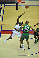 LeBron James of Cleveland puts up a shot over the Boston defense.