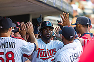 Minnesota Twins Denard Span #2 is congratulated in the dugout during a game against Baltimore Orioles at Target Field in Minneapolis, Minnesota on July 16, 2012.  The Twins defeated the Orioles 19 to 7 setting a Target Field record for runs scored by the Twins.  © 2012 Ben Krause
