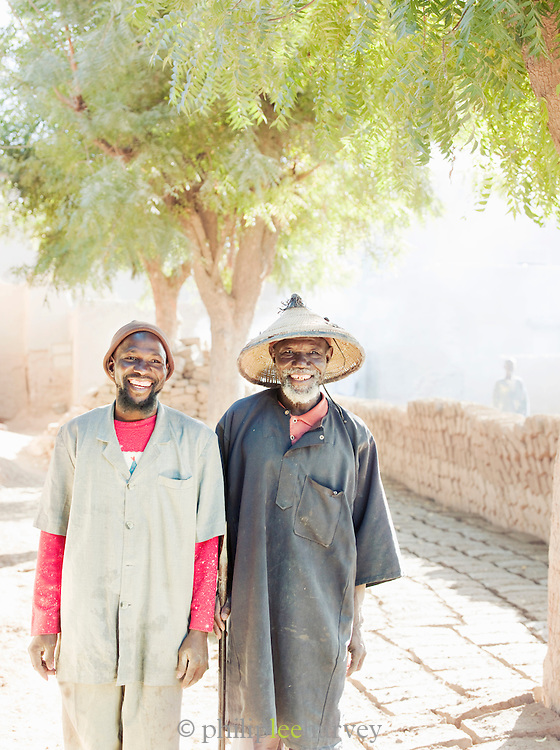 A master mason and his son, both well known for their skill in building using mud, in Djenné, Mali
