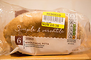 Reduced price label packet Tesco wholemeal pitta bread, UK