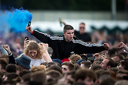 © Licensed to London News Pictures . 05/06/2015 . Manchester , UK . A man with a flare in the crowd . Evening concerts featuring headliners , The Courteeners , playing a homecoming gig , at Heaton Park in Manchester in front of 25,000 people , the evening before the Parklife music festival . Photo credit : Joel Goodman/LNP