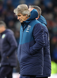 West Ham United manager Manuel Pellegrini appears dejected at half time during the Premier League match at Turf Moor, Burnley.