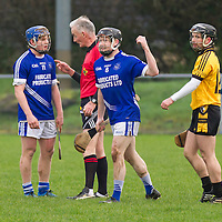 Cratloe's Padraic Collins receives a warning from referee Ambrose Heagney