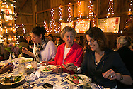 Cohasset, MA 05/11/2013.Diners, including from left Beth Baron, Mary Hartshorne, and Jenny White enjoy a farmhouse salad of shaved asparagus, wild arugula, pickled radish, and a farm fresh egg during Holly Hill Farm's farm to table dinner on Saturday evening..Alex Jones / www.alexjonesphoto.com