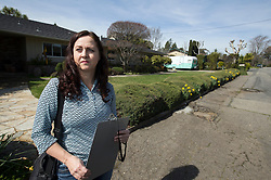 """Nikko Lindley, who has been a real estate appraiser for 17 years in the Bay Area, poses for a photograph in her typical """"uniform,"""" Thursday, March 9, 2017 in Oakland, Calif. (Photo by D. Ross Cameron)"""