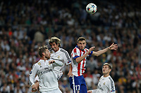 Real Madrid's Sergio Ramos and Fabio Coentrao and Atletico del Madrid´s Saul Niguez during quarterfinal second leg Champions League soccer match at Santiago Bernabeu stadium in Madrid, Spain. April 22, 2015. (ALTERPHOTOS/Victor Blanco)