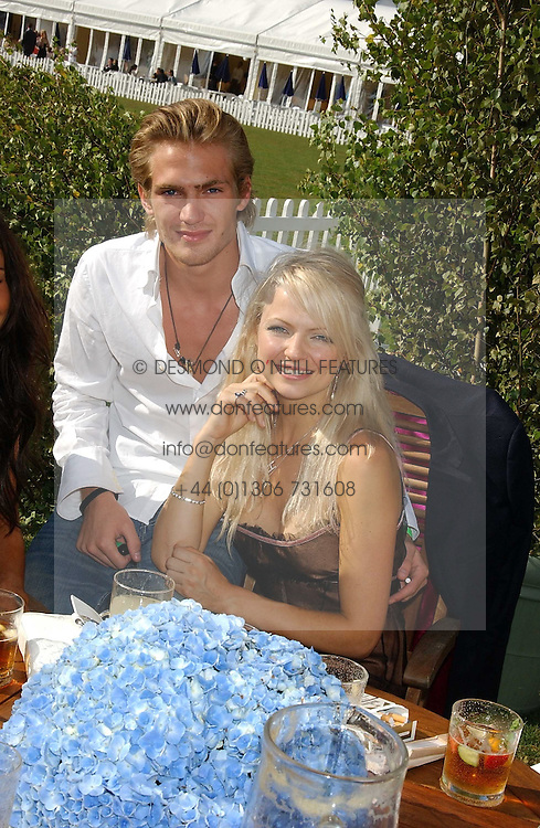 JACOBI ANSTRUTHER-GOUGH-CALTHORPE and HANNAH SANDLING at the 2005 Cartier International Polo between England & Australia held at Guards Polo Club, Smith's Lawn, Windsor Great Park, Berkshire on 24th July 2005.<br /><br />NON EXCLUSIVE - WORLD RIGHTS