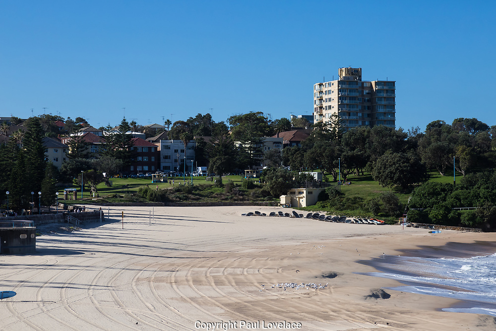People exercising and social distancing as they walk passed Coogee Beach along the Coogee coastal walk, during the coronavirus lockdown in Sydney, Australia.