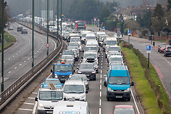 © Licensed to London News Pictures. 08/03/2021. London, UK. Heavy traffic and long queues on the A3 Kingston bypass this morning as schools open in England for the first time this year. From today, Monday, 8th March 2021 Stage1 of the easing of lockdown comes into force with children heading back to their classrooms and two friends will be allowed to socialise out side of their bubble for a coffee or picnic. However, pubs, shops and restaurants still remain closed. Photo credit: Alex Lentati/LNP