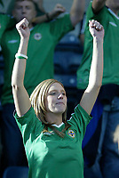 Photo: Andrew Unwin.<br />Northern Ireland v Wales. World Cup Qualifier.<br />08/10/2005.<br />A Northern Ireland fan cheers on her team despite their loss to Wales.