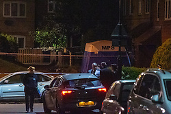 © Licensed to London News Pictures. 18/05/2020. London, UK. A police forensic tent sits on Wiltshire Gardens. Police were called at 20:22BST to reports of shots fired in Wiltshire Gardens, N4. Metropolitan Police Service attended along with London Ambulance Service and found a man, believed to be aged in his 20s, suffering gunshot injuries. The man was pronounced dead at the scene. Photo credit: Peter Manning/LNP