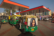 Electric rickshaws also known as electric tuk-tuks or e-rickshaws queueing for garage fast charging on 4th February 2018 in Jaipur, Rajasthan, India.