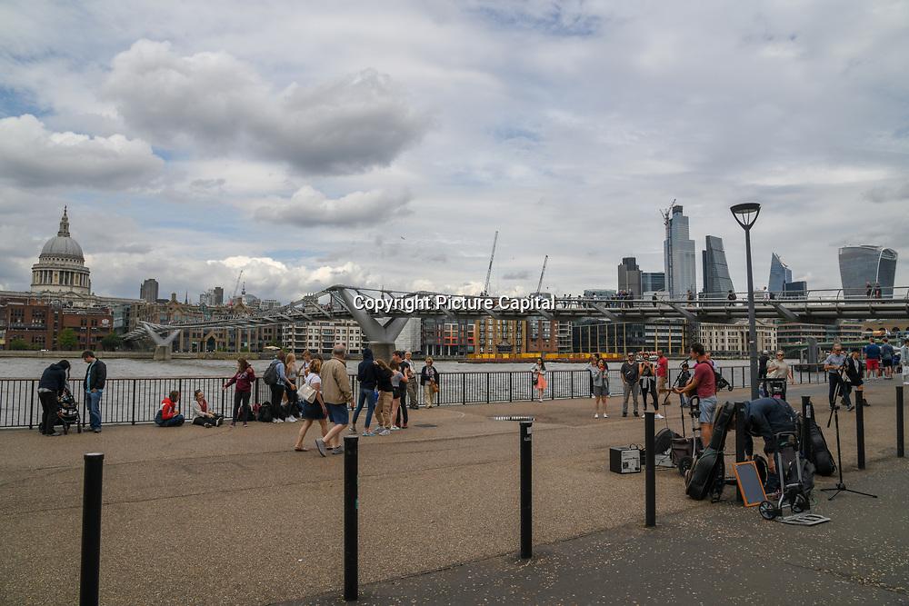 Millennium Bridge known at wobbly bridge, on 18 July 2019, City of London, UK.