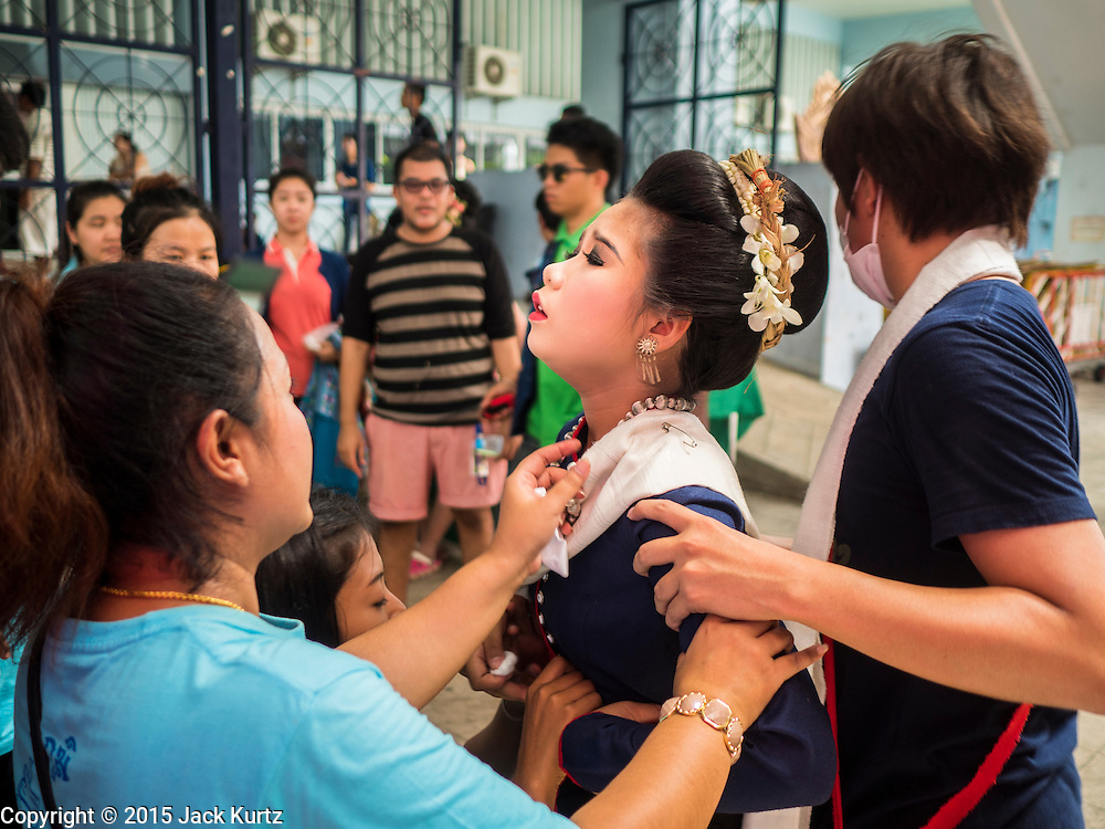09 AUGUST 2015 - BANGKOK, THAILAND:  Performers get ready to go on stage at a talent show to honor Queen Sirikit of Thailand before her birthday. Sirikit, born Mom Rajawongse Sirikit Kitiyakara on 12 August 1932, is the queen consort of Bhumibol Adulyadej, King (Rama IX) of Thailand. She met Bhumibol in Paris, where her father was the Thai ambassador. They married in 1950, shortly before Bhumibol's coronation. Sirikit was appointed Queen Regent in 1956. Sirikit produced one son and three daughters. As the consort of the king who is the world's longest-reigning head of state, she is also the world's longest-serving consort of a monarch. Sirikit suffered a stroke on 21 July 2012 and has since refrained from public appearances. Her birthday is celebrated as Mother's Day in Thailand.     PHOTO BY JACK KURTZ