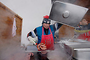 Italy, Madonna di Campiglio,cooking  salsicce outside Chalet FIAT.