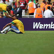 Neymar, Brazil, after defeat is comforted by team mate Romulo during the Brazil V Mexico Gold Medal Men's Football match at Wembley Stadium during the London 2012 Olympic games. London, UK. 11th August 2012. Photo Tim Clayton