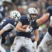 NEW HAVEN, CONNECTICUT - NOVEMBER 18: Quarterback Kurt Rawlings #6 of Yale hands off to running back Zane Dudek #33 of Yale during the Yale V Harvard, Ivy League Football match at the Yale Bowl. Yale won the game 24-3 to win their first outright league title since 1980. The game was the 134th meeting between Harvard and Yale, a historic rivalry that dates back to 1875. New Haven, Connecticut. 18th November 2017. (Photo by Tim Clayton/Corbis via Getty Images)