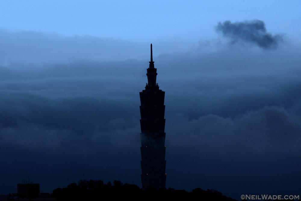 A storm rolls by Taipei 101 in Taipei, Taiwan.