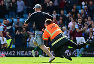 an Aston Villa fan is tackled by a steward as he Invades the pitch.  EFL Skybet championship match, Aston Villa v Birmingham city at Villa Park in Birmingham, The Midlands on Sunday 23rd April 2017.<br /> pic by Bradley Collyer, Andrew Orchard sports photography.