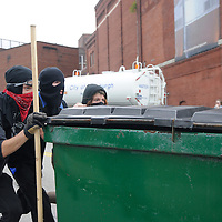 A group of protester rolls a trash dumpster down Liberty Avenue into police lines in Pittsburgh, Pennsylvania on September 24, 2009.   Pittsburgh is the host city for the two day  G20 Conference.     UPI /Archie Carpenter