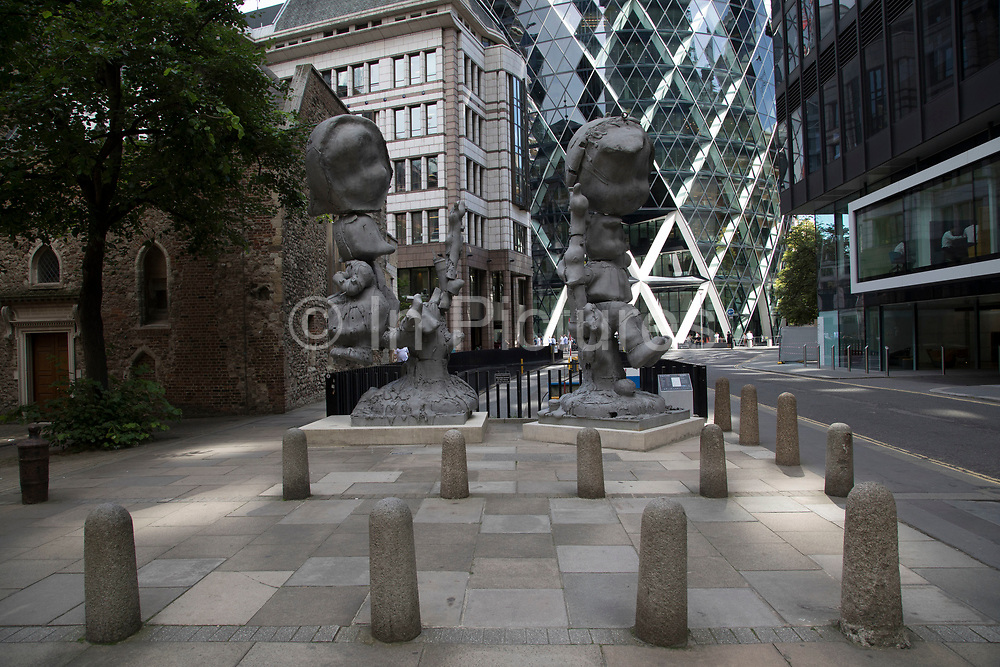 Sculpture in the City on July 17th 2017 in the City of London, England, United Kingdom. Each year, the critically acclaimed Sculpture in the City returns to the Square Mile with contemporary art works from internationally renowned artists in a public exhibition of artworks  open to everyone to come and interact with and enjoy. Apple Tree Boy Apple Tree Girl by Paul McCarthy 2010.