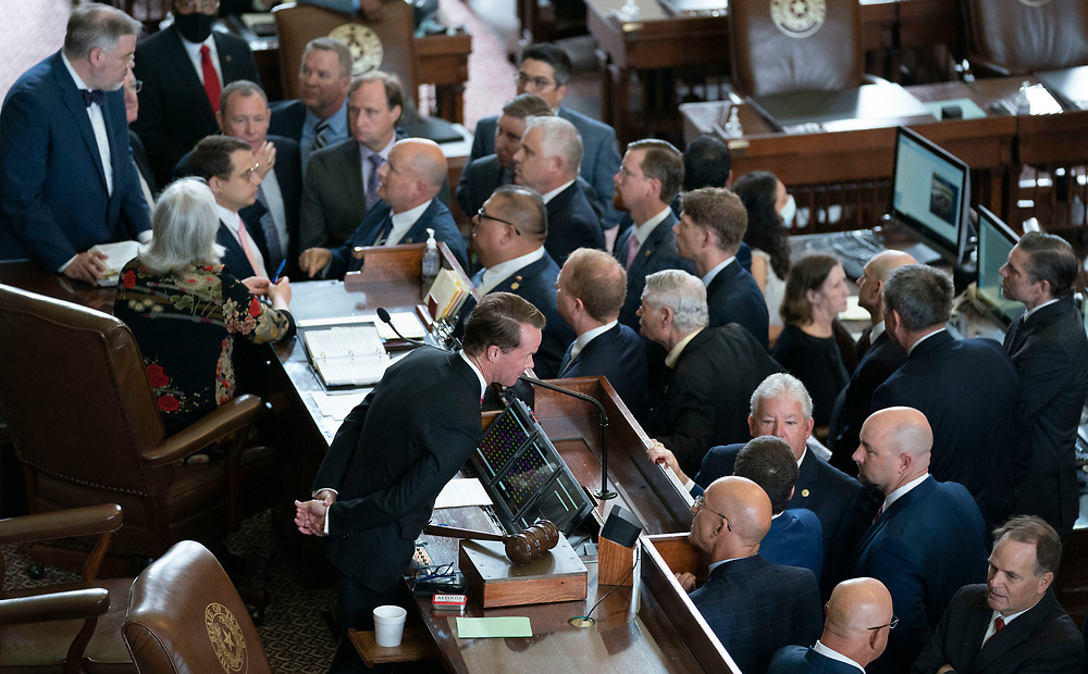 Speaker Dade Phelan talks to Republican members as the House attempts to get a quorum of members the day after most Democratic members left the state in protest of restrictive voting rights bills under consideration in the 87th Legislature. Less than the required 2/3 members showed up so the chamber cannot legally conduct business.