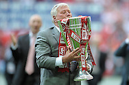 Rotherham United Chairmen Tony Stewart kissing the League One Playoff Trophy after their win. Skybet football league one play off final match , Leyton Orient  v Rotherham Utd at Wembley Stadium in  London on Sunday 25th May 2014.<br /> pic by John Patrick Fletcher, Andrew Orchard sports photography.