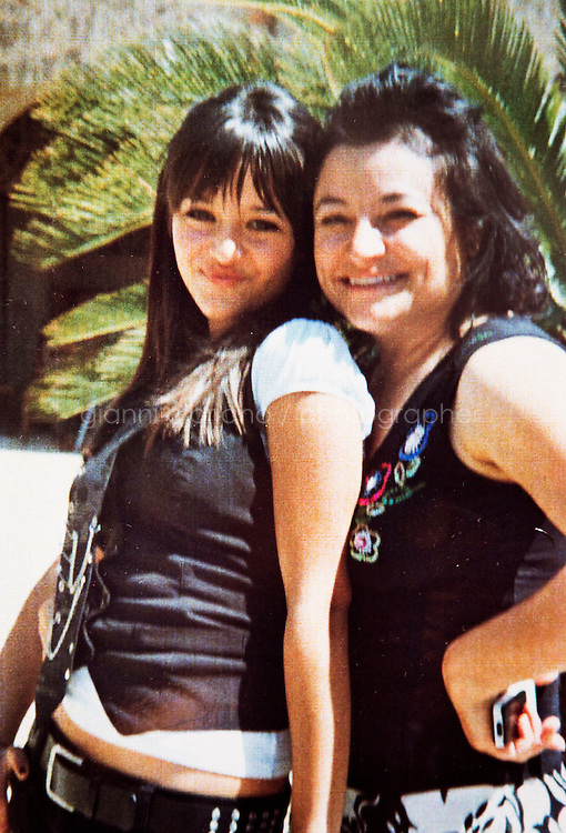 PRIOLO GARGALLO (SICILY), ITALY - 31 JULY 2013: (R-L) A photo of the missing and presumed dead Costa Concordia cruise ship passenger Mariagrazia Trecarichi and her daughter Stefania Vincenzi during their vacation in Barcelona in 2008.<br /> <br /> Mariagrazia Trecarichi is missing since January 14th 2012, the day of her 50th birthday, after the Costa Concordia shipwrekck at the  Giglio Island in Tuscany, Italy. Of the 3,229 passengers and 1,023 crew known to have been aboard, 30 people died,, and two more passengers are missing and presumed dead, inclusding Mrs Trecarichi. Mariagrazia Trecarichi had survived two cancers and decided to celebrate her 50th birthday on the Costa Concordia.