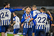 Davy Propper (Brighton) and Martin Montoya (Brighton) celebrate with Leondro Trossard (Brighton) following his goal giving Brighton & Hove Albion FC a 1-0 lead during the Premier League match between Brighton and Hove Albion and Norwich City at the American Express Community Stadium, Brighton and Hove, England on 2 November 2019.