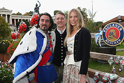 06.10.2013, Kaefers Wiesenschaenke, Muenchen, GER, der FC Bayern Muenchen beim Oktoberfest, im Bild Bastian Schweinsteiger (C) of Bayern Muenchen poses with Sarah Brandner and double of former Bavarian King Ludiwig 2nd in front of the ensemble of the Bavaria statue, a monumental bronze sand-cast 19th-century statue and the Hall of Fame (Ruhmeshalle). The Bavaria is the female personification of the Bavarian homeland and by extension its strength and glory // during the Oktoberfest 2013 beer festival at Kaefers Wiesenschaenke in Munich, Germany on 2013/10/06. EXPA Pictures © 2013, PhotoCredit: EXPA/ Eibner/ Eckhard Eibner<br /> <br /> ***** ATTENTION - OUT OF GER *****