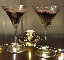 "Courteney Cox releases a photo on Twitter with the following caption: """"Wanna a fun drink recipe for New Year's Eve? Check out this divine (4 ingredient) CHOCOLATE MARTINI! https://t.co/XPPnjOFkPK"""". Photo Credit: Twitter *** No USA Distribution *** For Editorial Use Only *** Not to be Published in Books or Photo Books ***  Please note: Fees charged by the agency are for the agency's services only, and do not, nor are they intended to, convey to the user any ownership of Copyright or License in the material. The agency does not claim any ownership including but not limited to Copyright or License in the attached material. By publishing this material you expressly agree to indemnify and to hold the agency and its directors, shareholders and employees harmless from any loss, claims, damages, demands, expenses (including legal fees), or any causes of action or allegation against the agency arising out of or connected in any way with publication of the material."