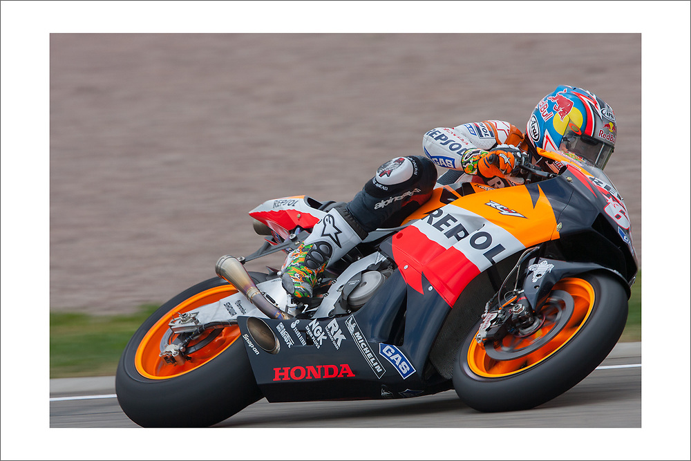 This print is of Nicky Hayden (1981-2017) on track at Sachsenring MotoGP during his world championship-winning season.