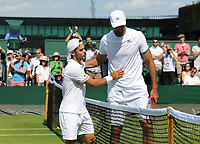 Tennis - 2019 Wimbledon Championships - Week One, Wednesday (Day Three)<br /> <br /> Men's singles, 2nd Round: Ivo Karlovic (CRO) v Thomas Fabbiano (ITA)<br /> <br /> Thomas Fabbiano consoles Ivo at the net after winning the match on  Court 14<br /> <br /> COLORSPORT/ANDREW COWIE