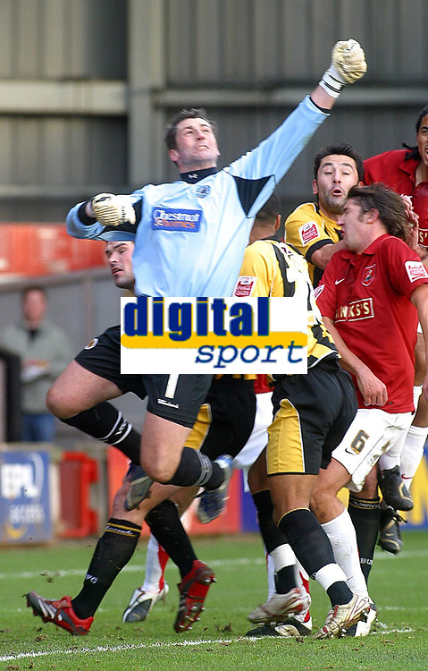 Photo: Dave Linney.<br />Walsall v Boston United. Coca Cola League 2. 27/01/2007.<br />Boston keeper Andy Marriott punches clear before Walsall's Ian Roper gets a look in.