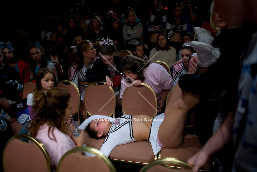 Samantha Boylan, 17,  of Xtreme All-Stars Pink Chicas, faints with exhaustion after competing in the NCA/NDA U.S. Championship held at the Hammerstein Ballroom Sat. March 10, 2007. Rising popularity in the sport of cheerleading has brought a significant increase in cheerleading related accidents and injuries. .