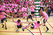 Milpitas High School sophomores compete in the human-centipede race during the annual Trojan Olympics, where students compete in various unorthodox events for class bragging rights, at Milpitas High School in Milpitas, California, on March 27, 2015. (Stan Olszewski/SOSKIphoto)